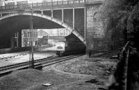 Aberdeen north end, 1975. A class 47 sits under Union Street bridge with the old north box behind and the lines into the former north end platforms lifted. The filled in turntable pit can be seen in the right foreground.<br><br>[John McIntyre&nbsp;/04/1975]