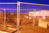 [Low quality shot] Behind the fence is the site of works at Raiths Farm. Earthmoving equipment and portacabins present.<br><br>[Ewan Crawford&nbsp;27/01/2007]