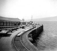 Wemyss Bay Pier. This siding held tank wagons for refuelling ferries, it remained long after all the goods lines were lifted. Note the lifeboat behind the buffers. The white roofed building at the end was a signal box operating four semaphore berth indicators on the post above it.<br><br>[John Gray&nbsp;/09/1967]