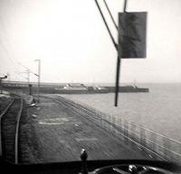 The first year of the <i>blue trains</i>. Approaching Wemyss Bay with one of the ABC car ferries at the pier. The trackbed on the right was the goods line.<br><br>[John Gray&nbsp;/09/1967]
