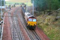 EWS 66025 brings the 1155 Chalmerston - Rugeley coal train out of the up loop at Abington and onto the WCML on 31 January 2007 having been sidelined for a passing Pendolino.<br><br>[John Furnevel&nbsp;31/01/2007]