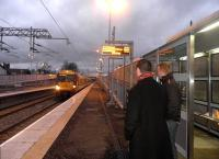 A train arrives to pick up passengers waiting at Caldercruix on the morning of 13 February 2011, first day of services at the new station.<br><br>[John Yellowlees&nbsp;13/02/2011]