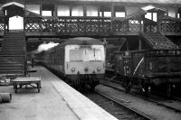 An Inverness service departs from platform 6 at Aberdeen in March 1973 with demolition work underway on the north end walkway.<br><br>[John McIntyre&nbsp;/03/1973]