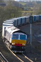 Stobart Rail 66411 <I>Eddie the Engine</I> approaching Greenhill Lower Jct on 6 February with the Daventry - Grangemouth <i>Tesco</I> containers.<br><br>[Bill Roberton&nbsp;6/02/2007]