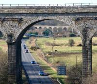 Viaduct through a viaduct. Shortly after leaving the main line south of Markinch station, the Leslie branch crossed the Leven on a substantial viaduct, seen here in the centre background on 6 February 2007, looking west through one of the arches of Markinch Viaduct.<br><br>[John Furnevel&nbsp;06/02/2007]