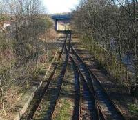 View east at Cameron Bridge with the River Leven on the right and the overgrown line of the former route to the Fife coast curving away to the left beyond the bridge. February 2007.<br><br>[John Furnevel&nbsp;11/02/2007]
