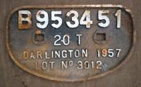 <b>Wagon plate</B> bearing legend <i>B953451 - 20T - Darlington - 1957 - Lot No 3012</i> from wagon at Arnott Youngs, Dalmuir for breaking up. No body but appeared to be two platform end brake van.<br><br>[Alistair MacKenzie&nbsp;01/11/1979]