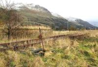 Remains of loading facilities and sidings at Menstrie in February 2007 looking east along the Ochils towards Alva.<br><br>[John Furnevel&nbsp;04/02/2007]