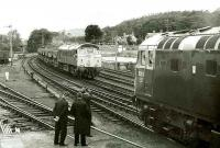 Conversation piece at Pitlochry in 1973 as 5313 waits at the platform to cross a class 24 hauling a ballast train.<br><br>[Bill Roberton&nbsp;//1973]