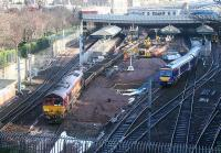 Waverley update 14 February. 66115 at the front end of a spoil train in platform 17 as a Glasgow shuttle finds a path into 14.<br><br>[John Furnevel&nbsp;14/02/2007]