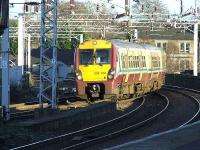 334009 crossing Wallneuk Junction as it enters Paisley Gilmour Street with a Gourock service.<br><br>[Graham Morgan&nbsp;10/01/2007]