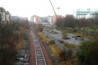 The remains of Lochend South Junction in March 2007. The surviving line runs to Powderhall refuse depot. Left at the end of the fence was the Abbeyhill loop and to the right the line to Leith Central via Lochend North Junction and Easter Road Halt (alongside the football stadium).<br><br>[John Furnevel&nbsp;19/03/2007]