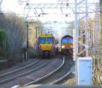 66403 on the daily <i>W. H. Malcolm</i> Elderslie to Grangemouth service passes 334011 outside Paisley Gilmour Street.<br><br>[Graham Morgan&nbsp;10/01/2007]