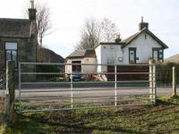 Looking west over the old level crossing towards Walkerburn station in 2007. The canopy area has been converted into an extension to the station building with another built over the trackbed. The former station masters house stands on the left.<br><br>[John Furnevel&nbsp;19/02/2007]