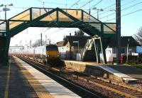 A low winter sun casts long shadows at Prestonpans in February 2007 as a GNER service speeds through on its way to Kings Cross.<br><br>[John Furnevel&nbsp;21/02/2007]