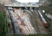General view of Waverley west end situation on 28 Feb with an Aberdeen bound HST leaving platform 19 and, on the right, a 158 in South West Trains livery. <br><br>[John Furnevel&nbsp;28/02/2007]