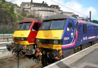 Sleeper locomotives stabled in the short bay at the east end of Waverley on 3 March 2007, with 90024 in First ScotRail/EWS Sleeper livery and 90039 in standard EWS colours.<br><br>[John Furnevel&nbsp;03/03/2007]