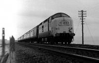 Deltic 9000 near Cove with the 0900 Aberdeen - Kings Cross on 07 December 1974.<br><br>[John McIntyre&nbsp;07/12/1974]