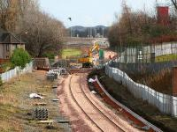 View east from Bruce Street footbridge on 5 March 2007, showing work being carried out at Hilton Road level crossing in the middle distance. Beyond that, work is also in progress on the new Parkmill Roundabout, from which the rerouted B909 road traverses the formation via a new road bridge, enabling closure of the crossing.<br><br>[John Furnevel&nbsp;05/03/2007]