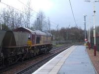 66020 racing through Johnstone station with coal empties heading for Hunterston.<br><br>[Graham Morgan&nbsp;27/02/2007]