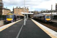 Dundee train leaving platform 2 on 3 March passes a Cowdenbeath service waiting in platform 0.<br><br>[John Furnevel&nbsp;/03/2007]