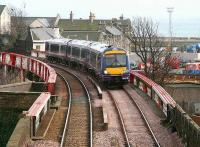 An Edinburgh bound train crossing the bridge over Burntisland High Street on 15 March 2007, shortly after leaving Burntisland station.<br><br>[John Furnevel&nbsp;15/03/2007]