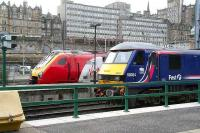 Waverley east end on 17 March with a Voyager standing alongside First ScotRail liveried locomotive 90024 stabled in the bay between Sleeper duties.<br><br>[John Furnevel&nbsp;17/03/2007]