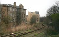 The lines from Abbeyhill Junction turn north off the ECML with the surviving platforms of Abbeyhill station just round the curve. Grab shot from a passing train in March 2007.<br><br>[John Furnevel 03/03/2007]