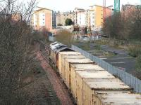An EWS class 66 with empty <i>Binliner</i> containers returning from Oxwellmains, having just passed through Meadowbank, approaches the former Lochend South Junction on 19 March 2007 on the way back to Powderhall depot. <br><br>[John Furnevel&nbsp;19/03/2007]