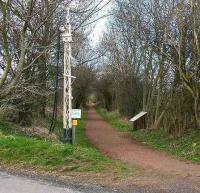 Looking northwest from the crossing at the former Saltoun station on the Gifford branch in March 2007. The old signal post points the way along the railway walk - information board on the right.<br><br>[John Furnevel&nbsp;24/03/2007]