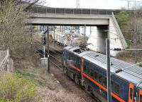 Down GNER train restarting from a red at Portobello Junction in March 2007. The bridge now carries the Portobello bypass. Its predecessor carried the Lothian Lines across the ECML, around Portobello Yards and on to Leith Docks. <br><br>[John Furnevel&nbsp;21/03/2007]