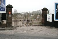 By 1930, thanks to an abundance of good quality local spring water and the railway, Duddingston played host to the seven breweries of Messrs Deuchar, Drybrough, Maclachlan, Raeburn, Steel Coulson, T.Y.Paterson and North British - all rail served. The yard entrance gates to the demolished T.Y.Paterson brewery stand alongside the site of the level crossing on Duddingston Road in 2007 - though probably not for much longer, given the surrounding area has been cleared ready for new commercial developments. [See image 60481]    <br><br>[John Furnevel&nbsp;28/03/2007]