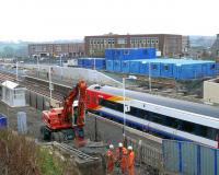 Workers discuss the weekend ahead. Here is the SWT 158786 again. Markinch station inprovements on 30 March.<br><br>[Brian Forbes&nbsp;30/03/2007]