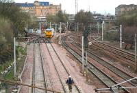Sunday engineering works at Larkfield Junction on 1 April 2007. The quadruple lines to the right are for Glasgow Central, the track machine is on the route through to Shields Junction, while branching off to the left are the lines to Muirhouse South Junction.<br><br>[John Furnevel&nbsp;01/04/2007]