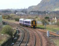 Diverted westbound train heading for Bathgate crosses Niddrie West Junction in the shadow of Arthurs Seat on 31 March.<br><br>[John Furnevel&nbsp;/03/2007]