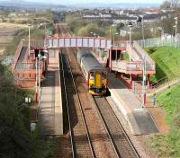 Sunshine on Baillieston, as a Glasgow Central - Whifflet service pulls into the station, April 2007.<br><br>[John Furnevel&nbsp;23/04/2007]