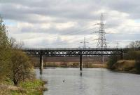 Looking east along the Clyde at Carmyle towards Westburn Viaduct in April 2007. The viaduct closed in May 1983 following the end of the freights between Carmyle Junction and Westburn Junction serving British Steel, Cambuslang.<br><br>[John Furnevel&nbsp;08/04/2007]