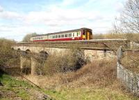 A Glasgow Central - Whifflet train crossing Clydebridge viaduct in April 2007 on the approach to Carmyle station.<br><br>[John Furnevel&nbsp;22/04/2007]