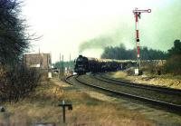A southbound car train approaches the closed station of Hemsen between Emden and Rheine in April 1976.<br><br>[John McIntyre&nbsp;/04/1976]