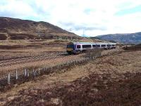 First Scotrail 170 unit goes over the summit, busy (as usual) A9 in background.<br><br>[John Gray&nbsp;10/04/07]