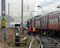A passing Pendolino gives a long and loud salute to the stately old lady as <I>Duchess of Sutherland</I> replenishes her tender in the down loop at Abington on 9 April 2007 with the 'Great Britain' railtour.<br><br>[John Furnevel&nbsp;09/04/2007]