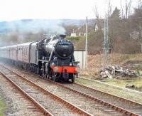 Stanier 8F 48151 coasts through Ardgay with <I>The Great Britain</I> railtour on 12 April.<br><br>[John Gray&nbsp;12/04/2007]