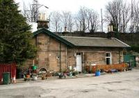 <I>The little house in Station Brae.</I> Sitting behind trees, in a small yard, off a busy road stands the old Portobello station house. The former island platform was reached via a subway through the embankment in the background, once accessible from both sides of the line. [See image 14165]<br><br>[John Furnevel&nbsp;10/04/2007]