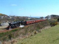 A member of the support crew checks the water level. Helmsdale and the North Sea in the background. On the right a sprinter sneaks by on a regular working to Wick/Thurso.<br><br>[John Gray&nbsp;12/04/2007]