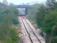 Diversion via Stirling weekend 14 - 15 April meant the line through Bridge of Earn was being occupied by Permanent Way staff to replace worn sleepers between Perth Road and the M90.<br><br>[Brian Forbes&nbsp;15/04/2007]