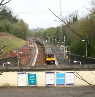 A Newton train arriving at Kirkhill on 15 April 2007. View from the road bridge over the broad mezzanine level where the station building once stood. [See image 8051]<br><br>[John Furnevel&nbsp;15/04/2007]