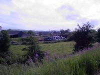 The plastic bags in the centre of shot are at the overbridge on the trackbed that led to Johnstone North. The trackbed in this area has now been put to use as farmland.<br><br>[Graham Morgan&nbsp;//2006]