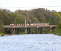 The WCML crossing the River Eden at Etterby with a train from Glasgow Central via Dumfries heading for Carlisle station. View east in April 2007.<br><br>[John Furnevel&nbsp;18/04/2007]