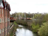 View north along the River Caldew at Willowholme on 18 April 2007 as a coal train heads south towards the station.<br><br>[John Furnevel&nbsp;18/04/2007]