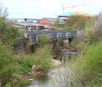 Looking north from the former Viaduct Yard, Carlisle on 18 April 2007. Spanning the river is what remains of the Caldew Viaduct, which formerly carried traffic on the joint goods lines, avoiding Citadel station. [See image 3549]<br><br>[John Furnevel&nbsp;18/04/2007]